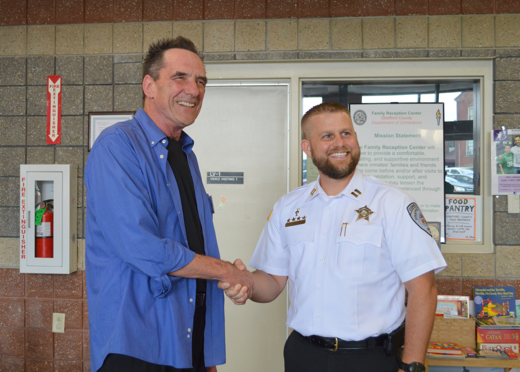 Strafford County Department of Corrections  Captain Chris Brackett,  joins Strafford County Family Reception Center volunteers  and community members in recognizing Paul Lally as volunteer of the year.  Paul has volunteered at the center for 3 years and has helped provided resources to improve the situation families face through incarceration of their loved ones.